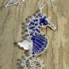 Michaeline McDonald will be shaping unique wire wrapped jewelry in a two week artisan spotlight show